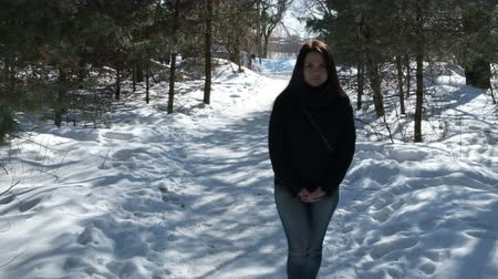aşk : A teenager on a walk in winter nature. Stok Video