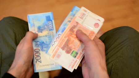 euro banknotes : Man counting russian paper money, rubles. Stock Footage