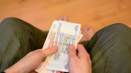 donate : Man counting russian paper money, rubles. Stock Footage