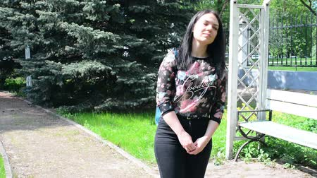 seducing : Beautiful young woman on a walk in the spring park