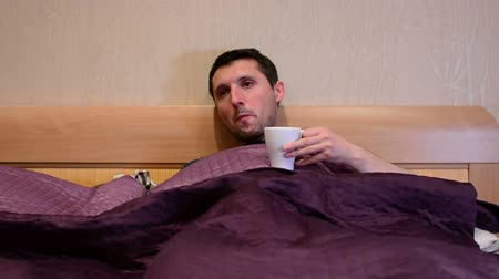 influenza : Sick ill caucasian man coughing in bed.