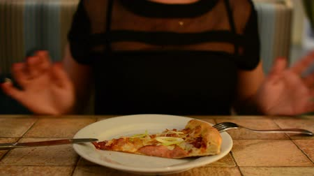 cheese slice : Girl eating pizza at the restaurant