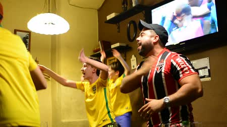 brazil : MOSCOW, RUSSIA - 30 JUNY 2018: Argentina and Brazil fans singing in the bar by viewing match FIFA 2018