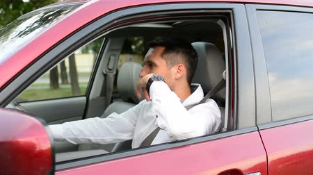 itself : Driver of a car being bored sitting in his vehicle waiting. Stock Footage