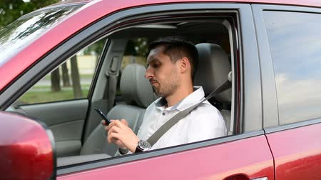 drive through : Driver of a car being bored sitting in his vehicle waiting. Stock Footage