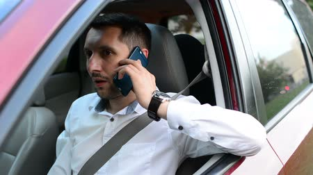 irresponsible : Driver of a car being bored sitting in his vehicle waiting. Stock Footage