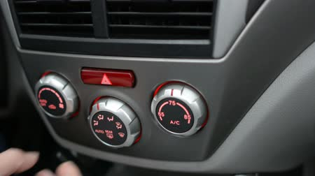 grãos : Button in the car. Man using automobile air conditioning system. Dual climate control in the car. Stock Footage