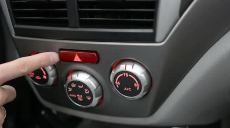 conditioner : Button in the car. Man using automobile air conditioning system. Dual climate control in the car. Stock Footage