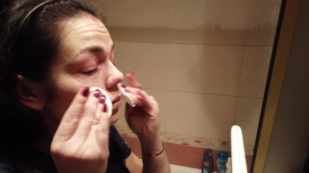 ped : Young Caucasian Woman Cleanse Face with Sponge