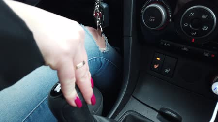 gearstick : The girl is shifting gearbox. Woman driver concept.