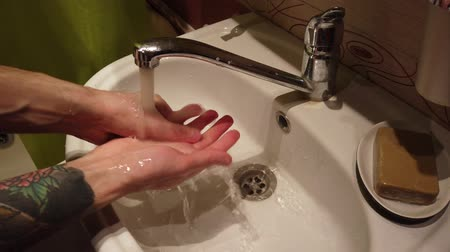sanitize : Man washing hands with soap Stock Footage