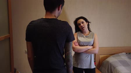 quarreling : Family quarrel, conflict. Husband and wife swear at home. Stock Footage