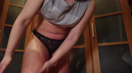 apply : Beautiful girl massagging herself with honey