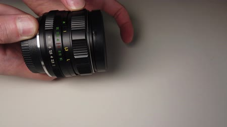 roll up : Dusty and dirty metallic photo lens. Stock Footage