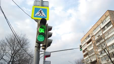 truck stop : Traffic lights red, yellow, green, green arrow. Sign give way, pedestrian crossing. Switching of the traffic light. Traffic in the big city