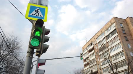 stoplight : Traffic lights red, yellow, green, green arrow. Sign give way, pedestrian crossing. Switching of the traffic light. Traffic in the big city