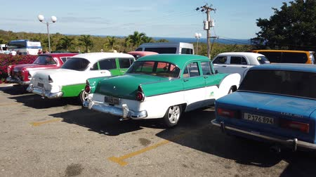 auto parking : HAVANA, CUBA - APRIL 2019: Vintage classic American cars parked.