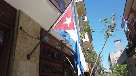 socialism : Flag of Cuba is developing in the wind. Cuba flag hanging on the building