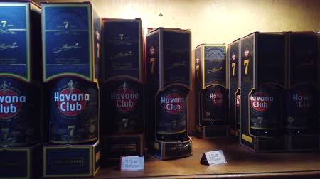 convidado : HAVANA, CUBA - APRIL 2019: Bottles of shelf on the store. Havana Club, Legendario, Santiago de Cuba