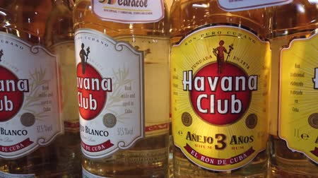 invité : HAVANA, CUBA - APRIL 2019: Bottles of shelf on the store. Havana Club, Legendario, Santiago de Cuba