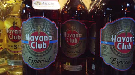 fodormenta : HAVANA, CUBA - APRIL 2019: Bottles of shelf on the store. Havana Club, Legendario, Santiago de Cuba