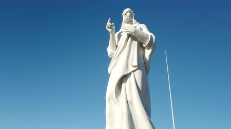 megmentő : View of Jesus Christ with open arms shifting to cloudless sky, vertical panorama