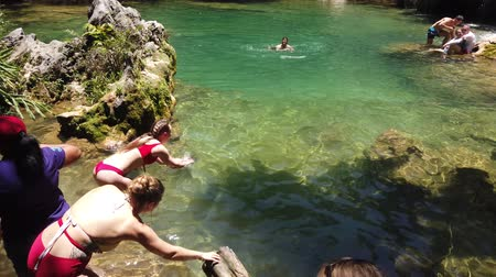 kuba : CUBA - APRIL 2019: People bathe in the wild. Travel of tourists in the mountains.