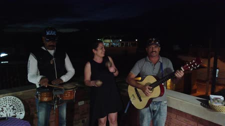 serenade : Trinidad, Cuba - April 2019: Cuban musicians perform in a restaurant or cafe.