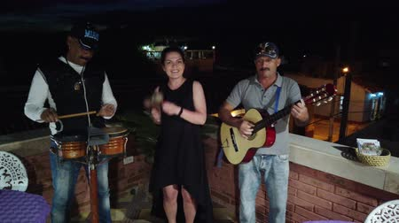 busking : Trinidad, Cuba - April 2019: Cuban musicians perform in a restaurant or cafe.