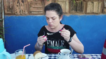 veranda : Beautiful young woman smokes a cigarette. Girl having Breakfast on veranda. Dostupné videozáznamy