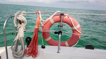 rescue : Red life buoy over blue calm sea water background. Lifebuoy on the boat