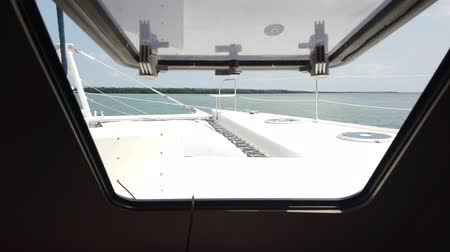 casco : Look out the window of the boat catamaran