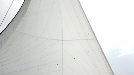 winch : White sails fluttering during the sea journey. Yachting as an relaxation active lifestyle. Stock Footage