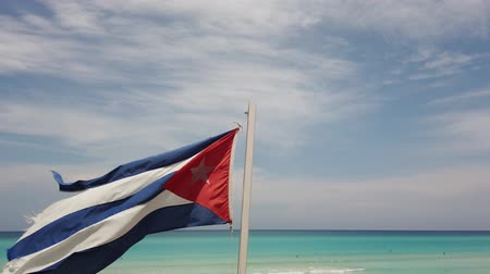 коммунизм : Cuban flag flying on the beach Cuba, Varadero.