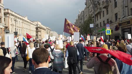 veteran's day : RUSSIA, MOSCOW - MAY 9, 2019: Immortal Regiment - Procession Stock Footage