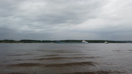 eksport : River shipping. Barge with cargo is on the river. Sunny day with a cloudy sky.