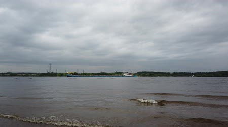 boa : River shipping. Barge with cargo is on the river. Sunny day with a cloudy sky.