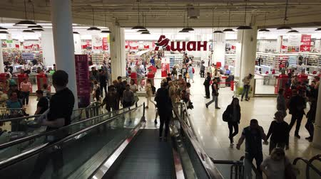 消費者運動 : Moscow, Russia, July 2019: Interior of Aviapark shopping center. Escalator in the shopping center with people. People spend their weekends at the mall and make holiday gift shopping.