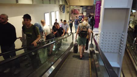 spendere : Moscow, Russia, July 2019: Interior of Aviapark shopping center. Escalator in the shopping center with people. People spend their weekends at the mall and make holiday gift shopping.