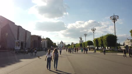 documentary : MOSCOW - JULY, 2019: People in park of VDNKH. Exhibition of Achievements of national economy VDNKH - largest exhibition, museum and recreational complex in world.