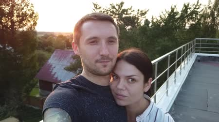 self portrait photography : Cute couple take selfie by sunset. Young couple traveling take a selfie portrait with the spectacular landscape on the background.