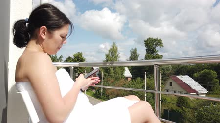 vaporizer : Attractive young girl is smoking on balcony with magnificent sun flare. Summer time, cigarette or beauty. Stock Footage