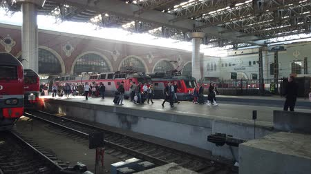 busy line : MOSCOW, RUSSIA - AUGUST, 2019: Hurrying passengers for train from Kazan railway station. Going by train in Russia. People go traveling with luggage.