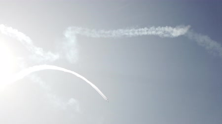 aerobatic : Airplanes flying on the background of blue sky and leaving a condensation trail. 4K