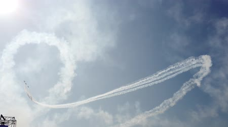 aerobatic : Military fighters soars high into the sky. Bright sun. Cool footage.