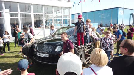 crawlers : 30 AUGUST 2019 MOSCOW, RUSSIA: Outdoors exhibition of military airplanes MAKS 2019 - Luxury crawler car Bentley Ultratank of Russian popular blogger Academeg.