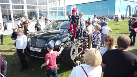 housenka : 30 AUGUST 2019 MOSCOW, RUSSIA: Outdoors exhibition of military airplanes MAKS 2019 - Luxury crawler car Bentley Ultratank of Russian popular blogger Academeg.