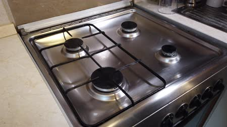 grime : Cleaning the stove in the home kitchen. Housekeeping concept. Hand with sponge washing the stove, close up Stock Footage