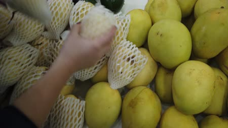 mangosteen : Sale tropical Vietnam fruits on the counter of the market. Girl chooses exotic fruits in the store. Stock Footage