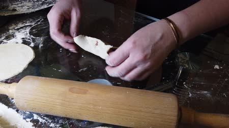pelmeni : Woman adds some flour to dough on table. Step by step cooking homemade dumplings guide.